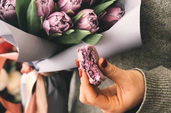 person-holding-pink-tulip-bouquet