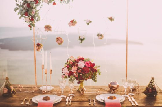 pink-and-red-roses-centerpiece-near-silverwares